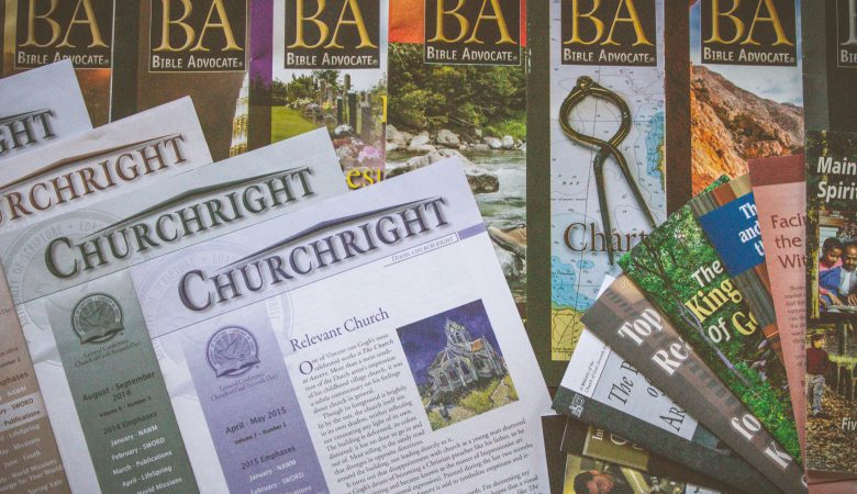 Printed materials laid out together including Churchright, BA, and various tracts