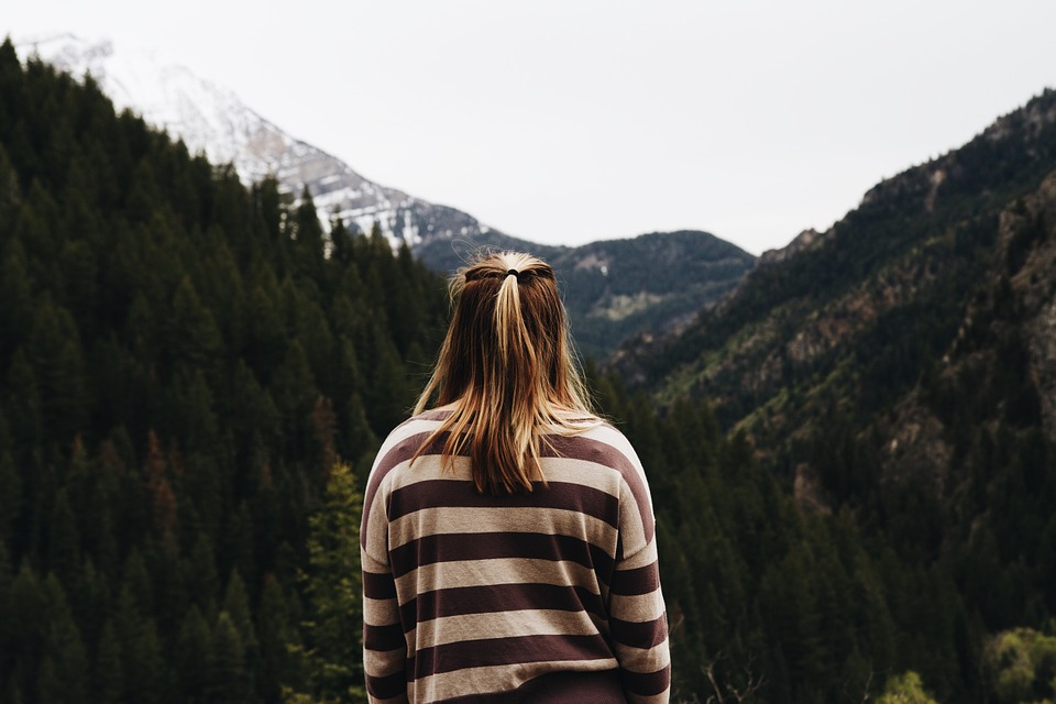 person staring at a mountain landscape