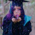 college grad with confetti