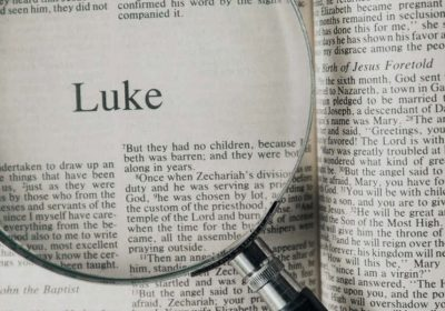 Bible opened to the Gospel of Luke