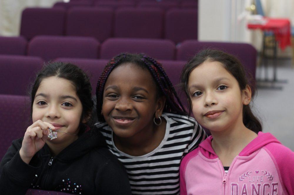 3 smiling little girls