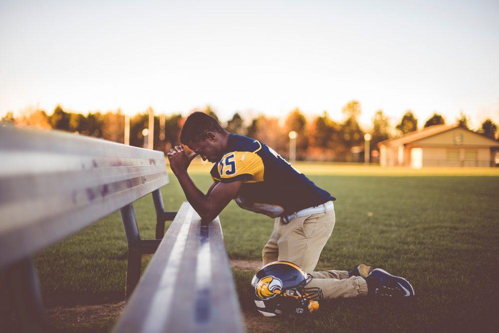 football player praying