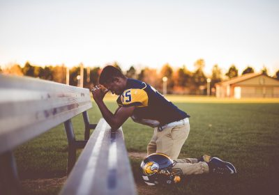 football player praying